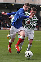 Dylan Dykes being tackled by Liam Henderson in the Celtic v Rangers City of Glasgow Cup Final match played at Firhill Stadium, Glasgow on 29.4.13,  organised by the Glasgow Football Association and sponsored by City Refrigeration Holdings Ltd.