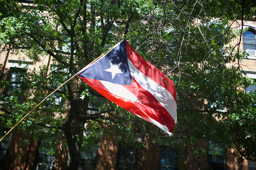 BROOKLYN, NY - June 12, 2016: Sunset Park on the day of the Puerto Rican Day along Fifth Avenue.<br /> <br /> Credit: Clay Williams.<br /> <br /> &copy; Clay Williams / http://claywilliamsphoto.com