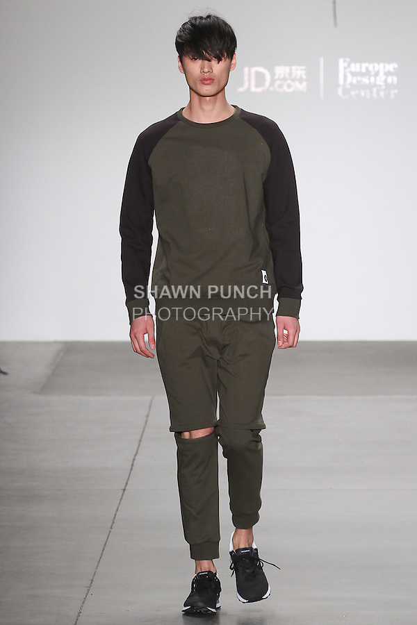 Model walks runway in an outfit for the Tim Cahill Fall 2016 collection, for the JD Fashion Fall 2016 runway show at Pier 59 Studios for NYFW: The Shows, during New York Fashion Week Fall 2016.