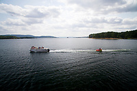 Boaters pull an inflatable towable intertube on Lake Ouachita, Arkansas on Tuesday, Aug. 21, 2018. (Photo by James Brosher)