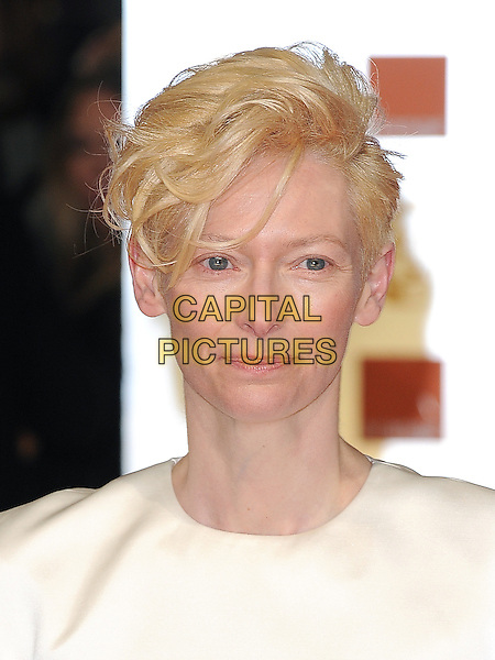 Tilda Swinton.The Orange British Academy Film Awards ( BAFTA ), Royal Opera House, Bow St., London, England..February 12th, 2012.baftas headshot portrait white .CAP/BEL.©Tom Belcher/Capital Pictures.