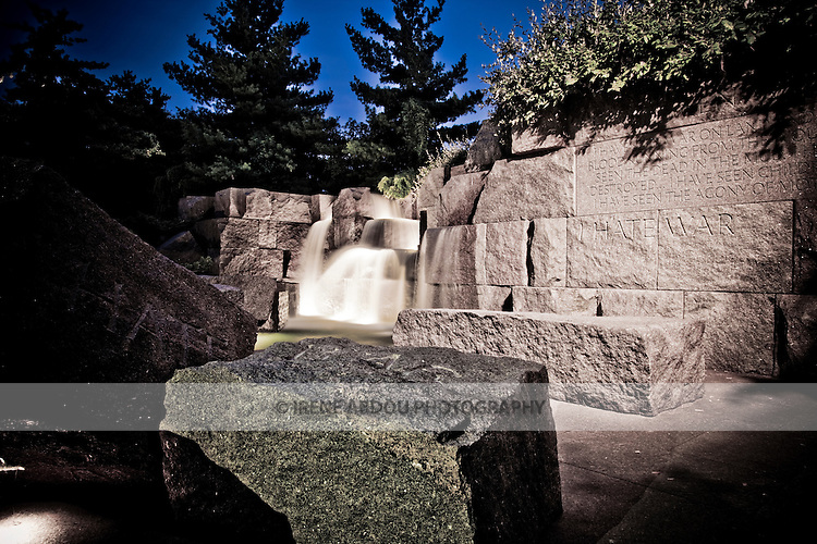 "The Franklin Delano Roosevelt (FDR) Memorial in Washington, DC houses four outdoor galleries, or rooms, each one commemorating a different segment of his presidency.  Quiet cascades of water flow throughout the memorial, and FDR quotes, such as ""I hate war"" are engraved into large rocks and stone walls."