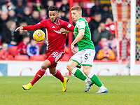 7th March 2020; Pittodrie Stadium, Aberdeen, Scotland; Scottish Premiership Football, Aberdeen versus Hibernian; Funso Ojo of Aberdeen and Greg Docherty of Hibernian compete for possession of the ball