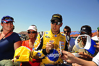Apr 25, 2009; Talladega, AL, USA; NASCAR Sprint Cup Series driver Kyle Busch signs autographs during qualifying for the Aarons 499 at Talladega Superspeedway. Mandatory Credit: Mark J. Rebilas-