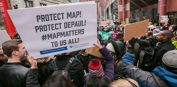 Students from DePaul University join other university students as they gather outside the Thompson Center in downtown Chicago Tuesday, Feb. 15, 2016, to urge Gov. Bruce Rauner to sign SB 2043. The bill would free up Monetary Award Program (MAP) grants for an estimated 128,000 low-income students to finance their college educations. (DePaul University/Jamie Moncrief)