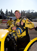 Nov 10, 2013; Pomona, CA, USA; NHRA pro stock driver Jeg Coughlin Jr celebrates after clinching the 2013 pro stock championship during the Auto Club Finals at Auto Club Raceway at Pomona. Mandatory Credit: Mark J. Rebilas-