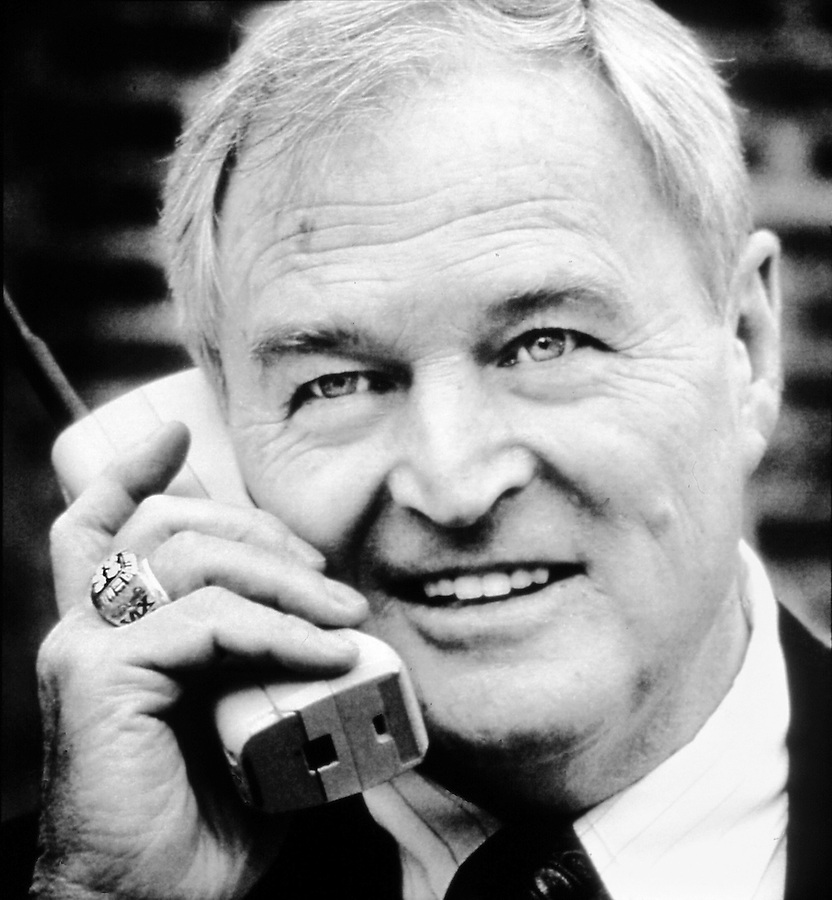 Chuck Noll receives the call from the NFL in 1993 informing him that he was being inducted into the Hall of Fame. He was in Pasadena, CA at an NFL pregame party with his wife before the afternoon Super Bowl held at the Rose Bowl. copyright JimMendenhallPhotos.com 1993. Note the Four Diamonds, one for each Super Bowl win, on his ring.