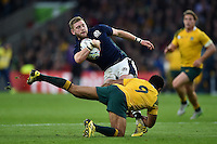 Finn Russell of Scotland is tackled by Will Genia of Australia. Rugby World Cup Quarter Final between Australia and Scotland on October 18, 2015 at Twickenham Stadium in London, England. Photo by: Patrick Khachfe / Onside Images
