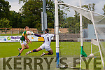 Goal time<br /> ------------<br /> Killian Spillane puts the ball past Wexfords keeper Richard Cleary for the 3rd goal in the All Ireland junior championship semi final last Saturday in Dungarvan