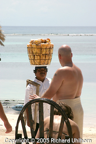 A Mexican beach vendor engages a visitor along the beach in Costa Maya, Mexico which is south of Cancun on the Mexican Riveria.