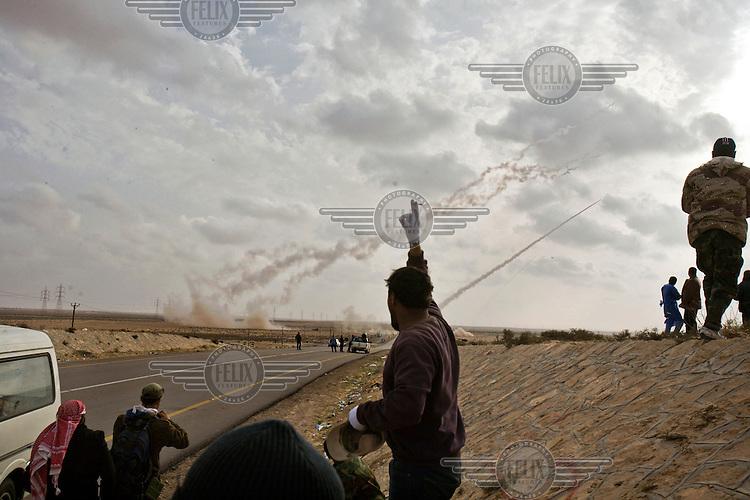 Rebels launch rockets against Gaddafi forces on a highway between Ajdabiya and Brega. On 17 February 2011 Libya saw the beginnings of a revolution against the 41 year regime of Col Muammar Gaddafi.