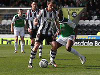 Paul McGowan shields from Isaiah Osbourne in the St Mirren v Hibernian Clydesdale Bank Scottish Premier League match played at St Mirren Park, Paisley on 29.4.12.