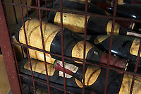 Bottles aging in the cellar. 1982. Boutari Wineries, Steinmachos, Naoussa, Macedonia, Greece
