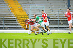 Mark Reen Kilcummin/Rathmore and Kieran Slattery Legion tussle for the loose ball during the County Champship final in Fitzgerald Stadium last Thursday evening