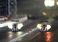 Oct 30, 2015; Las Vegas, NV, USA; NHRA top fuel driver Steve Torrence (left) races alongside Larry Dixon during qualifying for the Toyota Nationals at The Strip at Las Vegas Motor Speedway. Mandatory Credit: Mark J. Rebilas-USA TODAY Sports