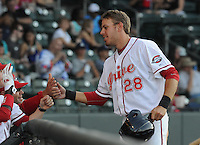Outfielder Drew Turocy (28) of the Greenville Drive is congratulated after scoring a run in a game against the Charleston RiverDogs on June 2, 2012, at Fluor Field at the West End in Greenville, South Carolina. Greenville won, 10-4. (Tom Priddy/Four Seam Images)