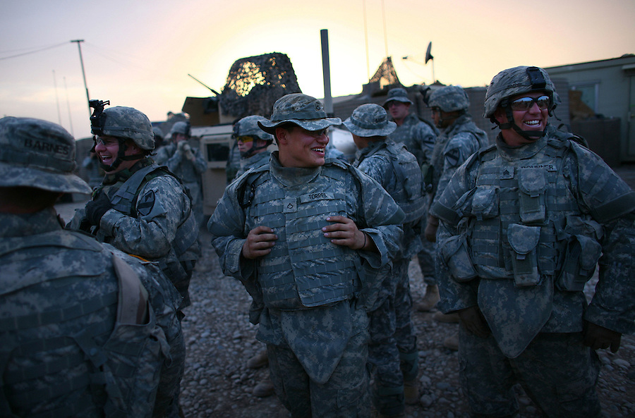 Soldiers from 1-12 Infantry 3HBCT 1st Cavalry Division relax and chat before the start of an air assault mission looking for insurgent prison and training facilities in the countryside near the Diyala provincial capital, Baqubah, on Monday May 28, 2007.