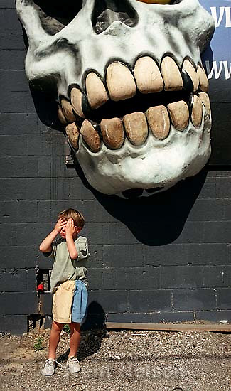 Noah Nelson in front of the skull at the Institute of Terror.<br />