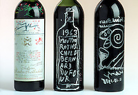 Rare and original bottles of Chateau Mouton Rothschild red wine with the label and artwork designed by the famous artists