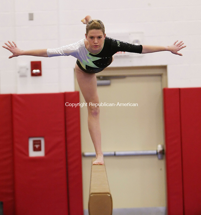 SOUTHBURY, CT, 01/10/08- 011009BZ10- New Milford's Jenny Cahalane competes on the beam during an invite gymnastics meet at Pomperaug High School Saturday.<br />  Jamison C. Bazinet Republican-American