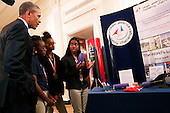 United States President Barack Obama listens to Stephanie Bullock  (R) who is part of a team from the US Virgin Islands that design rockets for the Team America Rocketry Challenge, during the 2015 White House Science Fair, a celebration of students winners of STEM (Science, technology, engineering and math) competitions from across the country at the White House, in Washington, DC on March 23, 2015. <br /> Credit: Aude Guerrucci / Pool via CNP