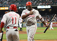 Philadelphia Phillies 1B Ryan Howard celebrates with SS Jimmy Rollins on Thursday May 22nd at Minute Maid Park in Houston, Texas. Photo by Andrew Woolley / Four Seam Images..