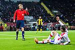 S&ouml;dert&auml;lje 2014-04-07 Fotboll Superettan Assyriska FF - Hammarby IF :  <br /> domare Glenn Nyberg manar p&aring; Assyriskas Levon Pachajyan  att resa sig upp  fr&aring;n marken i slutet av matchen vid st&auml;llningen 0-0<br /> (Foto: Kenta J&ouml;nsson) Nyckelord:  Assyriska AFF S&ouml;dert&auml;lje Hammarby HIF Bajen domare referee ref