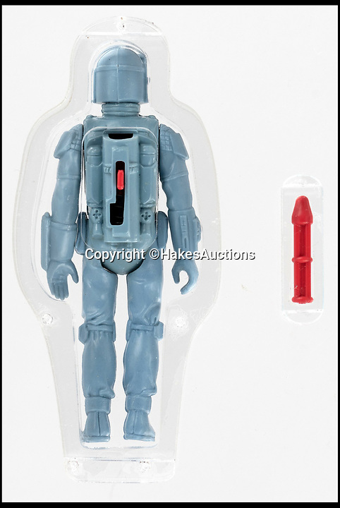 BNPS.co.uk (01202 558833)<br /> Pic:   HakesAuctions/BNPS<br /> <br /> An extemely rare rocket firing Boba Fett action figure has sold at auction for £90,000 ($112,926) - a world record for a Star Wars toy.<br /> <br /> The 3.75ins Kenner prototype of the bounty hunter was made in 1979 and was due to be released in conjunction with The Empire Strikes Back (1980) hitting the big screen.<br /> <br /> It was displayed at the 1979 New York Toy Fair but never made it into mass production, as there is thought to have been an issue with the rocket firing mechanism.<br /> <br /> Most prototypes were destroyed in the factory at the time, and only a handful of them have ever come to market.