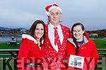 Mags Quillnan, Gary Kavanagh and Gemma O'Conne, ready for a run for fun at the Santa Fun run in memory of Fiona Moore, in the Tralee Bay Wetlands on Sunday