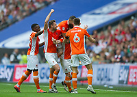 Blackpool players celebrating after Blackpool's Mark Cullen goal during the Sky Bet League 2 PLAY OFF FINAL match between Exeter City and Blackpool at Wembley Stadium, London, England on 28 May 2017. Photo by Andrew Aleksiejczuk.