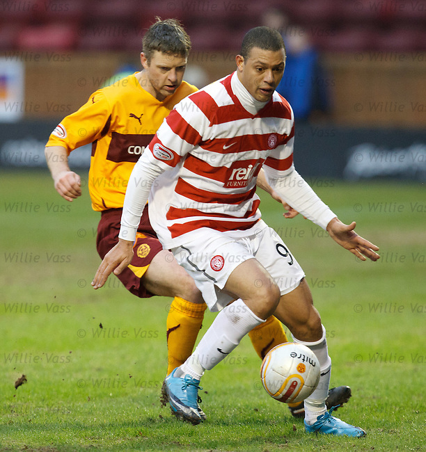 Mikael Antoine-Curier is shadowed by Motherwell's Stephen Craigan