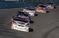 Nov. 16, 2008; Homestead, FL, USA; NASCAR Sprint Cup Series driver David Reutimann leads a pack of cars during the Ford 400 at Homestead Miami Speedway. Mandatory Credit: Mark J. Rebilas-