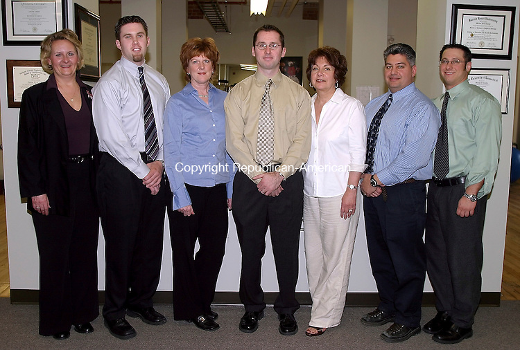WATERTOWN, CT- 06 APRIL 2005- 040605DA02.JPG - Physiotherapy Associates Inc. L-R Darlene M'Sadoques, (Physical Therapy) Jay Grimes, Diane Riedl, (Clinic Director) Bill Benesky, Pauline O'Rourke,( Athletic Trainer) Pete Catuccio, and (Physical Therapy) Mike LePage. For Marketplace. Staff photo. Darlene Douty.