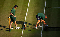 Ground staff changing the net and posts on Court 1<br /> <br /> Photographer Ashley Western/CameraSport<br /> <br /> Wimbledon Lawn Tennis Championships - Day 5 - friday 7th July 2017 -  All England Lawn Tennis and Croquet Club - Wimbledon - London - England<br /> <br /> World Copyright &not;&copy; 2017 CameraSport. All rights reserved. 43 Linden Ave. Countesthorpe. Leicester. England. LE8 5PG - Tel: +44 (0) 116 277 4147 - admin@camerasport.com - www.camerasport.com