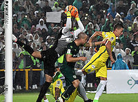 BOGOTA - COLOMBIA -25-02-2017: Diego Novoa (Izq.) y Andres Correa (Cent.) jugadores de La Equidad disputan el balón con Andres Uribe (Der.) jugador de Atletico Nacional, durante partido entre La Equidad y Atletico Nacional, por la fecha 5 de la Liga Aguila I-2017, jugado en el estadio Nemesio Camacho El Campin de la ciudad de Bogota. / Diego Novoa (L) and Andres Correa (C) players of La Equidad vie for the ball with Andres Uribe (R) player of Atletico Nacional, during a match between La Equidad and Atletico Nacional, for the  date 5 of the Liga Aguila I-2017 at the Nemesio Camacho El Campin Stadium in Bogota city, Photo: VizzorImage  / Luis Ramirez / Staff.