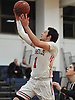 Kyle Acquavella #1 of MacArthur drives to the hoop during a game against Hjemly (Ringe, Denmark) in the Jeff Shaw Memorial Basketball Tournament at MacArthur High School on Thursday, Dec. 1, 2016. He scored a game-high 17 points in MacArthur's 65-43 win.