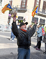 An unidentified man waves Catalonian flags on the street in front of the Palau de la Generalitat de Catalunya as he and others advocate for Catalonian independence from Spain on Tuesday, November 7, 2017. The building is a historic palace in Barcelona, Catalonia, that houses the offices of the Presidency of the Generalitat de Catalunya Barcelona. <br /> Credit: Ron Sachs / CNP /MediaPunch