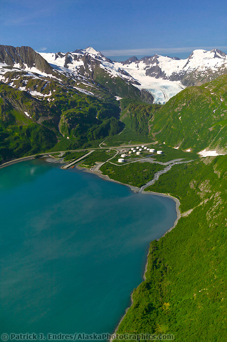 Aerial of storage tanks in Whittier and the entrance to the road tunnel, located at the end of Passage Canal in Prince William Sound, Alaska