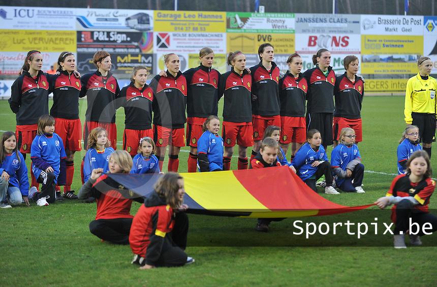 Qualification Women's Euro 2013 - Belgium - Iceland ; Belgie - Ijsland ; Armand Melis Stadion Dessel :..1 Sabrina Broos (GK) , 2 Stefanie Van Broeck , 3 Heleen Jaques , 5 Lorca van de Putte , 6 Niki De Cock (C) , 7 Julie Biesmans , 10 Janice Cayman , 11 Davina Philtjens , 14 Lien Mermans , 15 Marlies Verbruggen , 16 Tessa Wullaert. voor de belgische vlag.foto DAVID CATRY / Vrouwenteam.be