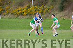 David Morans Kerins O'Rahilly's takes on Legions Donal Lyne and Shaun Keane during their club championship clash in Derreen on Saturday evening
