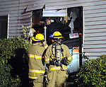 A home is heavily damaged after a car left the roadway and breached a home at 5 Niederwerfer Road in South Windsor early Saturday morning, Oct. 28, 2012. Two people in the home had to be rescued by the South Windsor Fire Department, the driver of the car was also injured and removed. Police were looking for a passenger of the car who witnesses said fled the scene. Vernon Police were looking people who were in the vehicle after an incident in that town. None of the injuries appeared to be life threatening. The house sustained significant structural damage and is unlivable. (Jim Michaud Photo)