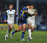Horacio Agulla of Bath Rugby is tackled by Bryce Heem of Worcester Warriors. Aviva Premiership match, between Worcester Warriors and Bath Rugby on February 13, 2016 at Sixways Stadium in Worcester, England. Photo by: Patrick Khachfe / Onside Images