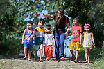 Deaconess Maria Jessica Cicillo walks with a group of children in Mt. Heights, Philippines, where she works as a Christian educator for a nearby United Methodist Church. She is a graduate of Harris Memorial College.