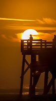 A fisherman looks over the ocean at Sunrise over the Main Street Pier, Daytona Beach, FL, February 2018. (Photo by Brian Cleary/www.bcpix.com)