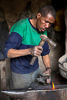 Rissani, Morocco.  Afro-Berber Blacksmith at Work in the Market