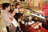 Customer and staff, Oak's Heart vinegar shop, Tokyo, Japan, November 16 2009.
