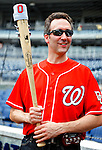 6 June 2010: Violinist Glenn Donnellan, a musician with the National Symphony Orchestra, holds his custom-made Louisville Slugger electric violin-bat prior to a game between the Washington Nationals and the Cincinnati Reds at Nationals Park in Washington, DC. The Reds edged out the Nationals 5-4 in a ten inning game. Mandatory Credit: Ed Wolfstein Photo