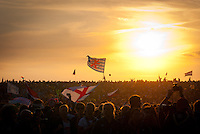 Audience with Luxembourg flag in the sunset. Photo: André Jörg/ Scouterna