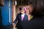 © Joel Goodman - 07973 332324 . 10/06/2016 . Manchester , UK . Comedian EDDIE IZZARD (c) and Manchester Central MP LUCY POWELL (r) door knocking in Hulme , Manchester , meet resident TREVOR GRANT (l) , who is in support of the Remain campaign , ahead of the UK's EU Referendum . Photo credit : Joel Goodman