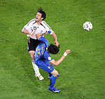 04 July 2006: Michael Ballack (GER) (13) is fouled by Vincenzo Iaquinta (ITA) (15) as he chases the ball. Italy defeated Germany 2-0 in overtime at Signal Iduna Park, better known as Westfalenstadion, in Dortmund, Germany in match 61, the first semifinal game, in the 2006 FIFA World Cup.